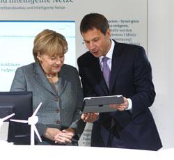 Kanzlerin Angela Merkel und René Obermann